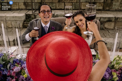 Jardin Etnobotanico, Oaxaca City outdoor marriage reception party award-winning photo that has recorded the Cheers to the newlyweds. The world's top wedding photographers compete at the WPJA