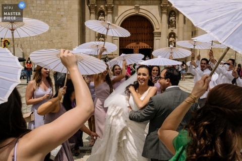 Oaxaca City outdoor marriage reception party award-winning photo that has recorded a Calenda wedding parade. The world's top wedding photographers compete at the WPJA