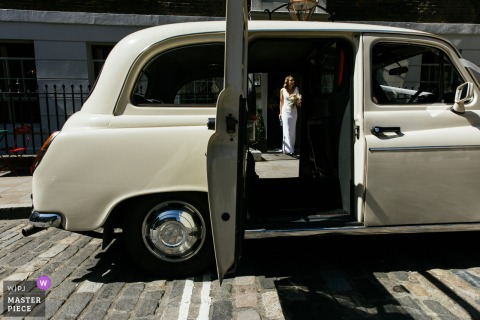 The Letter, London nuptial day award-winning image of the bride heading to wedding car. The world's best wedding photography competitions are hosted by the WPJA