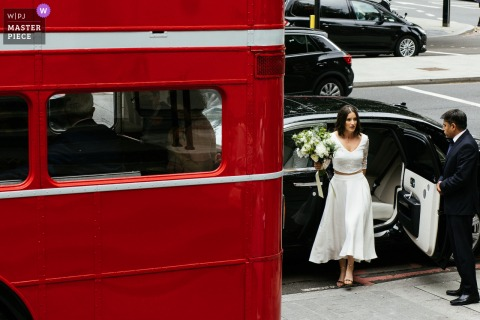 Marylebone Town Hall, London nuptial day award-winning image of the bride arriving for ceremony. The world's best wedding photography competitions are hosted by the WPJA