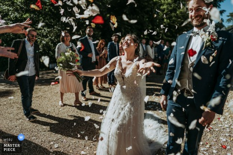 Villa Emma, Poitiers nuptial day award-winning image of the flower petal Ceremony exit. The world's best wedding photography competitions are hosted by the WPJA