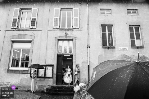 Grand Est nuptial day award-winning image a raining day but a big smile of the bride :)