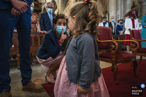 Saint Cast Church, France indoor marriage ceremony award-winning image showing the Sister and daughter of the bride. The world's best wedding picture competitions are featured via theWPJA
