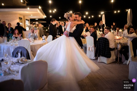 Hotel La Palma, Stresa, Italy indoor wedding reception party award-winning picture showing the couples First Dance. The world's most skilled wedding photographers are members of the WPJA