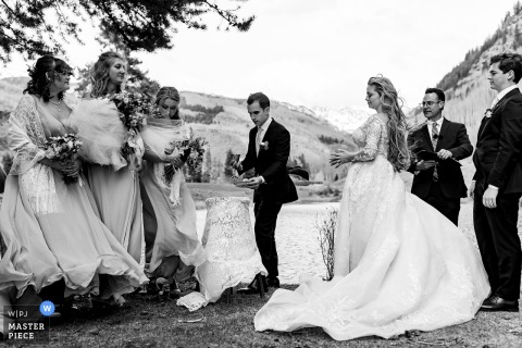 Colorado marriage ceremony award-winning image showing Windy moments outdoors in BW - from the world's best wedding photography competitions presented by the WPJA