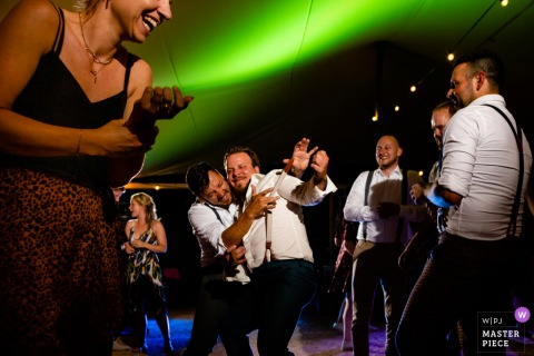 Urbino, Italy marriage reception party award-winning photo that has recorded the groom with friends at the dance floor - from the world's best wedding photography competitions offered by the WPJA