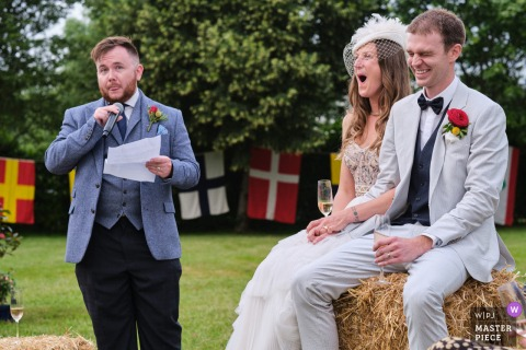 West Peckham, Kent nuptial day award-winning image of The best mans speech, superbly delivered in the driest possible way - from the world's best wedding photography competitions hosted by the WPJA