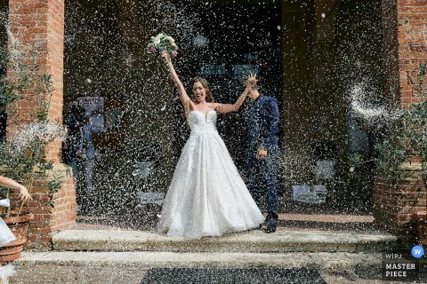 Chiesa di San Lucchese - Poggibonsi marriage ceremony award-winning image showing The explosive exit of the bride - from the world's best wedding photography competitions presented by the WPJA