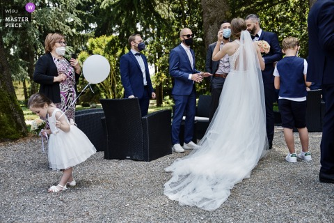 Villa Acquaroli, Bergamo marriage ceremony award-winning image showing the little girl who looks at her shoes - from the world's best wedding photography competitions presented by the WPJA