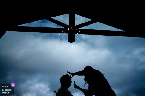 Mountain Top Inn - Chittenden, Vermont getting ready for marriage award-winning picture capturing The bride getting her makeup done below the clouds outside - from the world's best wedding photography competitions held by the WPJA