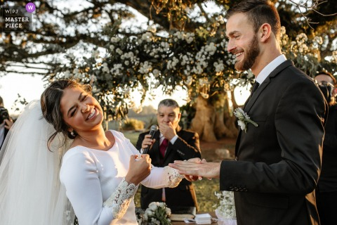 Estância das Oliveiras - Viamão marriage ceremony award-winning image showing the Bride laughing when she misses her wedding ring - from the world's best wedding photography competitions presented by the WPJA