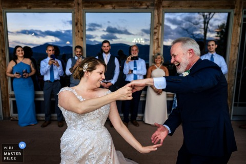 Mountain Top Inn - Chittenden Vermont marriage reception party award-winning photo that has recorded The bride dancing with her dad - from the world's best wedding photography competitions offered by the WPJA