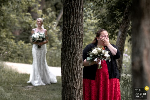 Ontario, Canada marriage ceremony award-winning image showing The maid of honour couldn't hold back the tears as she proudly walked down the aisle - from the world's best wedding photography competitions presented by the WPJA