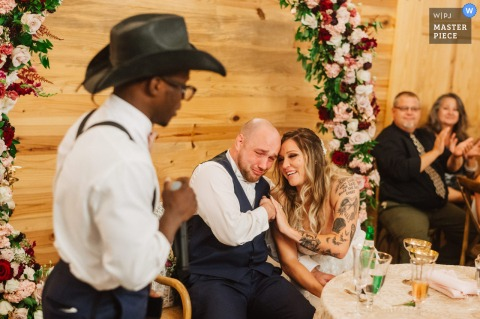 Atkinson Farm, Virginia marriage reception party award-winning photo that has recorded The best man speech making the groom tearful - from the world's best wedding photography competitions offered by the WPJA