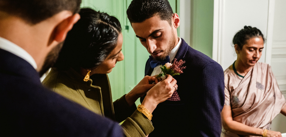 Cihangir, Istanbul, Turkey wedding photography by Ufuk Sarisen of the groom getting his flower pinned