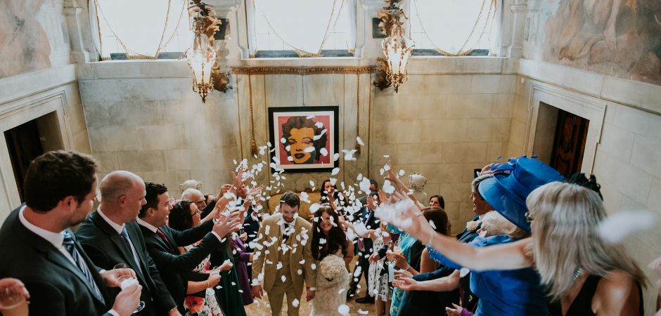 Image of the bride and groom under confetti at Cà Sagredo Hotel, Venice, Italy