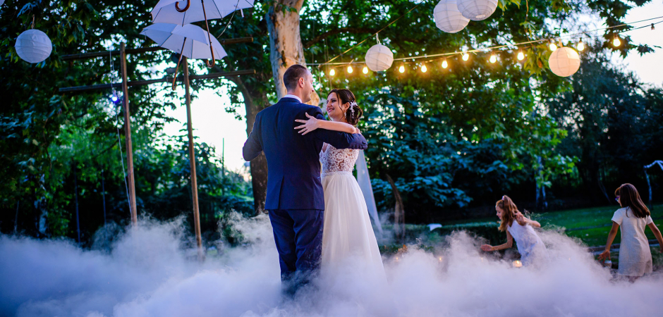 Sofia, Bulgaria bride and groom dancing image outdoors by Detelina Krasteva