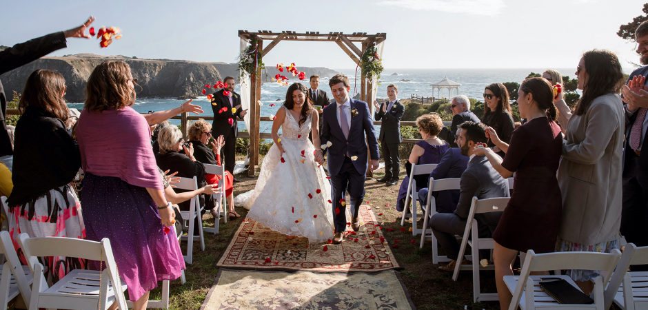 CA Beach Wedding Ceremony Images with Flower Petals by Joyce Perlman