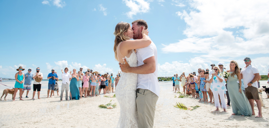 Beach photography kiss from a Marvin Key, Florida Keys wedding by photographer Julie Ambos