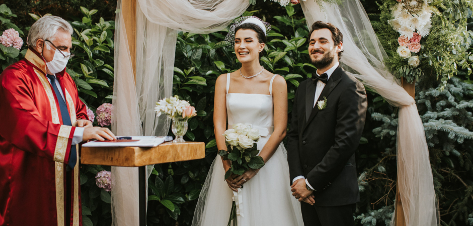 Bride and groom wedding ceremony image from an Istanbul, Turkey outdoor marriage - Images by Derya Engin