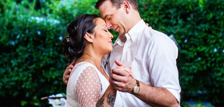 A Backyard Wedding photo of a couple during their first dance in New Jersey - Image by Michelle Arlotta