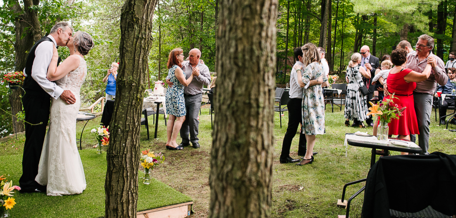 Guests are Social Distance dancing at this Ontario, Canada Backyard wedding event - Image by Viara Mileva