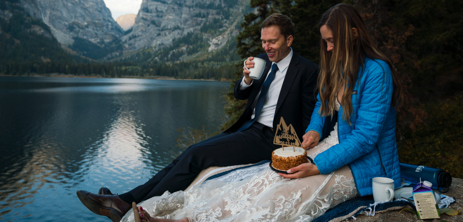 Bride and groom enjoying cake and coffee during their Grand Teton National Park, WY Adventure Elopement - Photography by JD Land