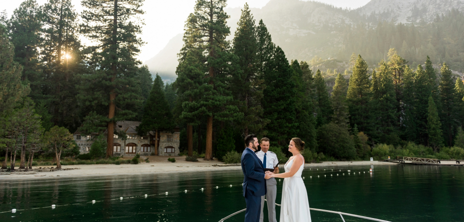 The bride and groom on a boat during a Lake Elopement Ceremony - Photography by Lauren Lindley