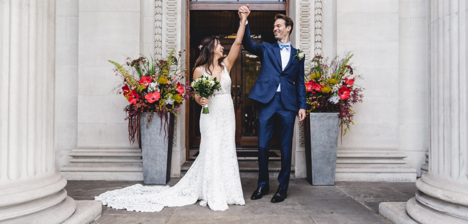 A wedding image of the bride and groom at Old Marylebone Town Hall for their Elopement - Photo by Ernie Savarese