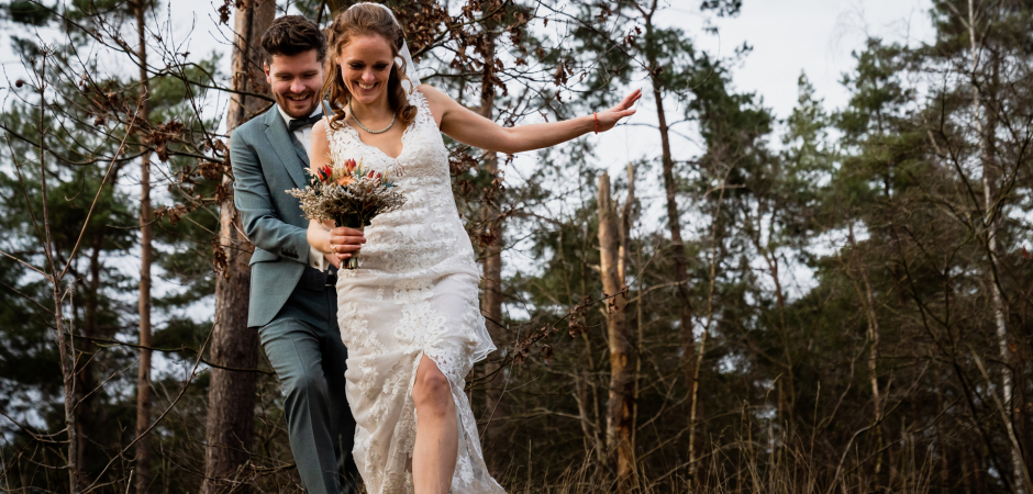 Outdoor wedding image of the bride and groom in the forest from a Harderwijk Town Hall, Netherlands - Elopement Photo by Caroline Elenbaas