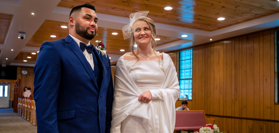 A TN church wedding image of the bride and groom at the alter from a Home Church in Pigeon Forge - Elopement Photography by Bryan Aleman