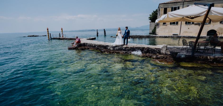 Outdoor wedding picture of the bride and groom at Torri Del Benaco Castle and Punta San Vigilio, Verona, Lake Garda - Italy Elopement Photography by Valeria Berti