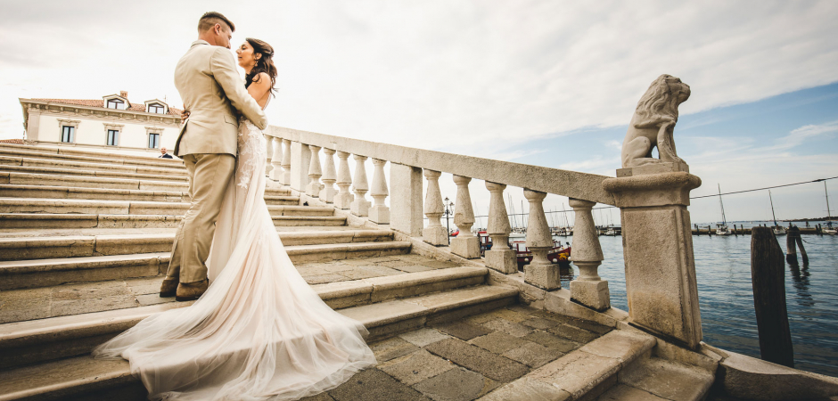 Outdoor wedding portrait of the bride and groom at Granso Stanco Restaurant, Chioggia, Italy - Elopement Photo by Carlo Bettuolo