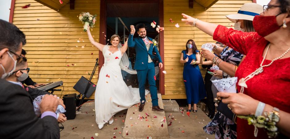 Wedding picture of bride and groom exiting church at the Hacienda Sitio de Mata, Turrialba, Cartago, Costa Rica - Elopement Photo by Mauricio Urena