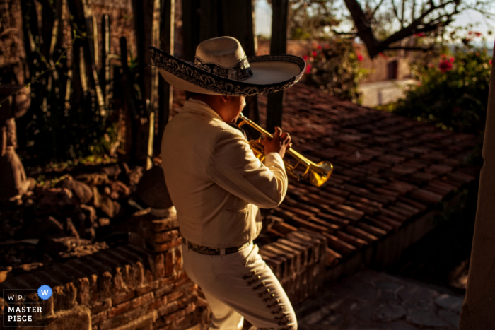 A San Diego wedding photographer created this image of a mariachi trumpet player walking through the woods