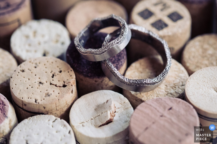 Bern wedding photographer captured this detail shot of the couples wedding bands resting on wine bottle corks