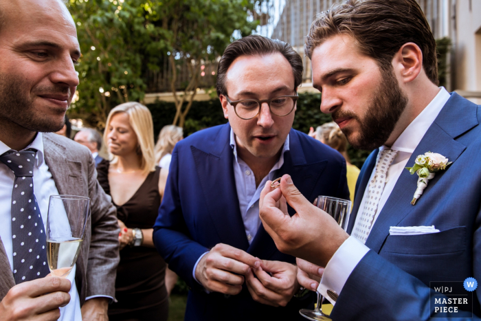 Rotterdam wedding photographer captured this image of a groom showing off the brides ring to stunned wedding guests