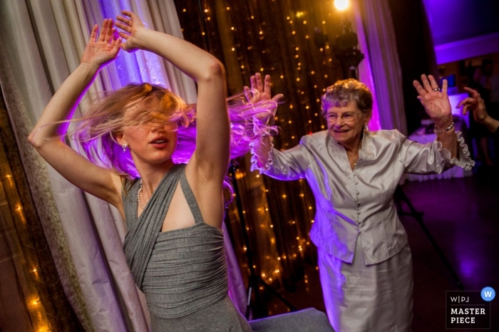 Austin wedding photography - Picture of a bridesmaid and the grandmother showing their best moves on the dance floor