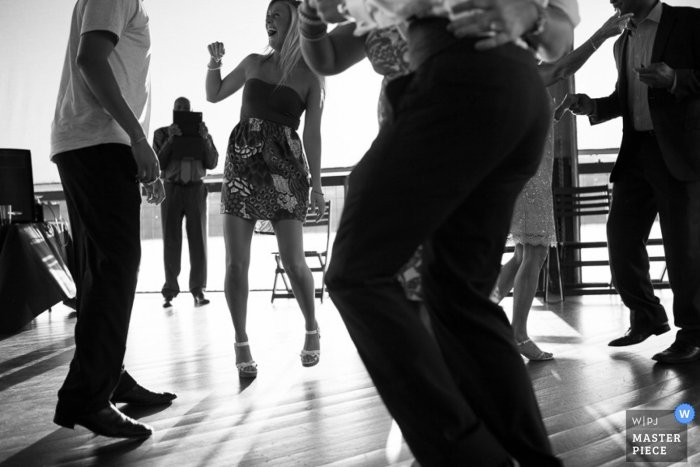 Austin wedding photographer captured this black and white photo of guests dancing on the outdoor dance floor