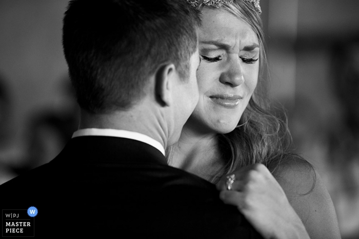 Documentary Wedding Photograph in Charlotte | Image contains: bride, groom, hug, cry, black, white