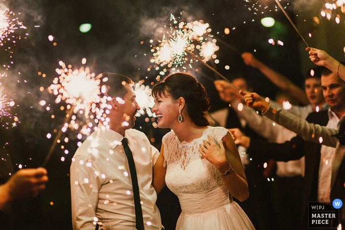 Saint-Petersburg Russia Wedding Reception Photographer | bride groom night sparklers guests laughing