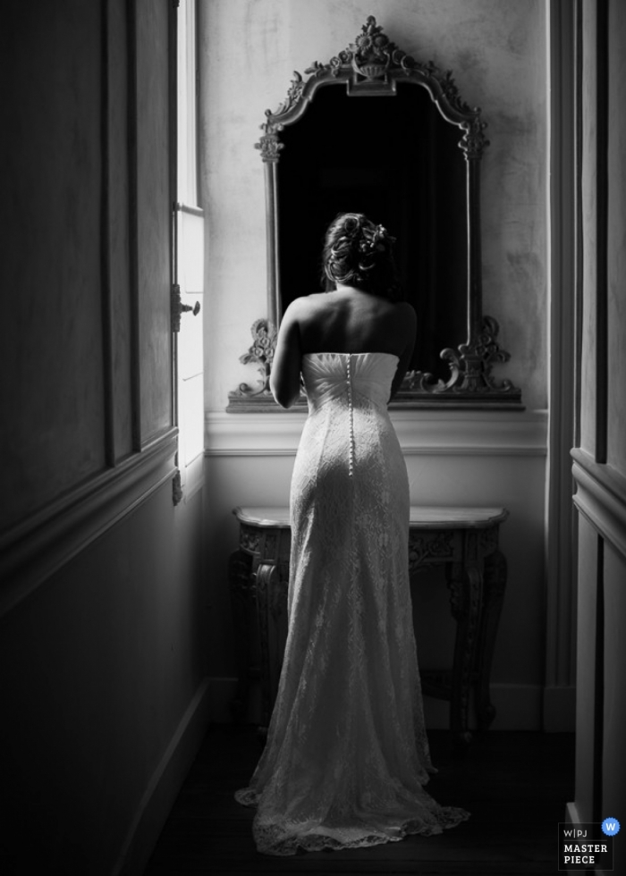 Nouvelle-Aquitaine Wedding Photography   Image contains: getting ready, bride, mirror, natural light, black and white