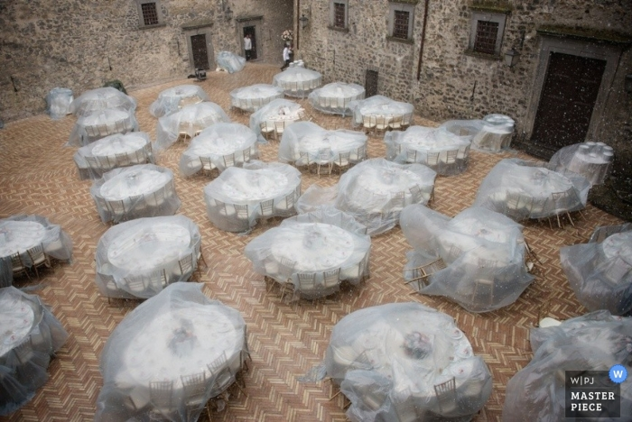 Tables are protected from the rain by plastic covers in this aerial shot taken by a Rome wedding photographer