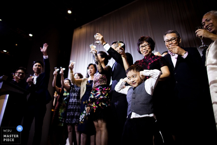 Singapore bride and groom make a toast at the reception   Asia wedding photo