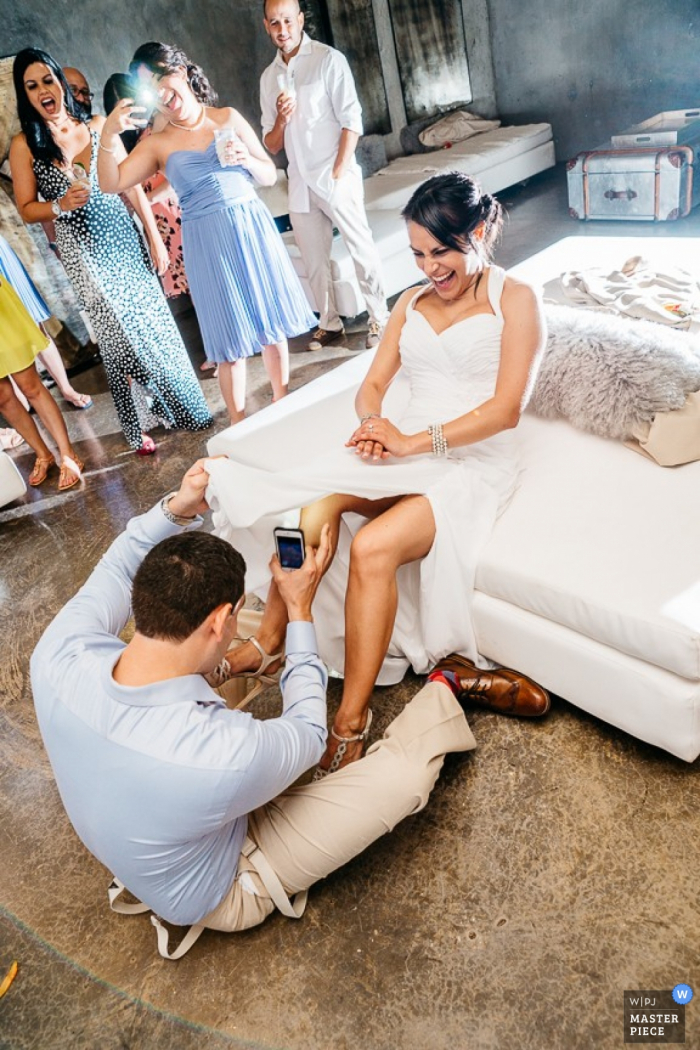 Puerto Rico groom getting the garter after the wedding | Caribbean wedding photo