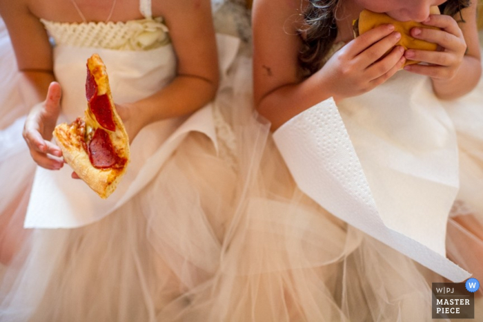 Nova Scotia wedding reception photography of flower girls eating pizza