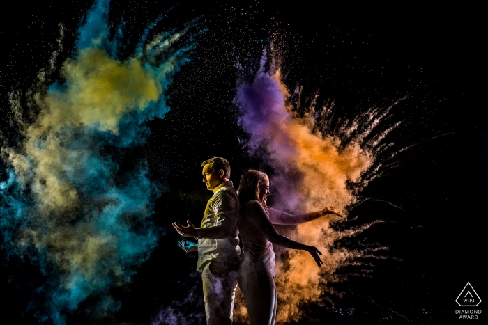Creative portrait session in Boulder, CO. Engagement photography at night with lights and colors.