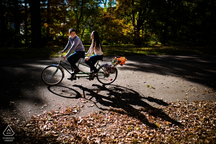 A couple going for a tandem bike ride during a wedding engagement photo session   Atlanta wedding photographer