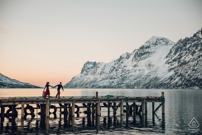 Stockholm Sweden mountain winter engagement portrait session on the boat dock at the lake