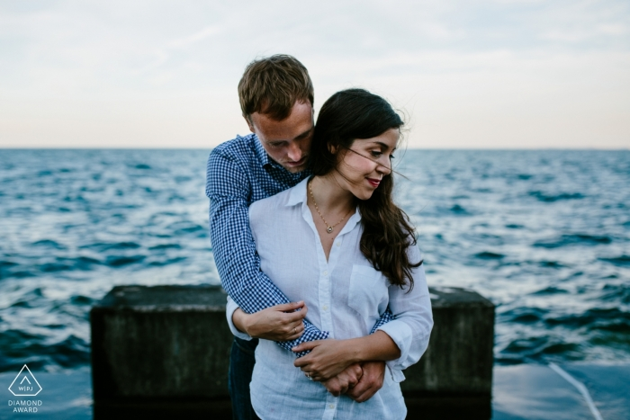 Denver pictures of a couple near the water by a top Colorado wedding engagement photographer
